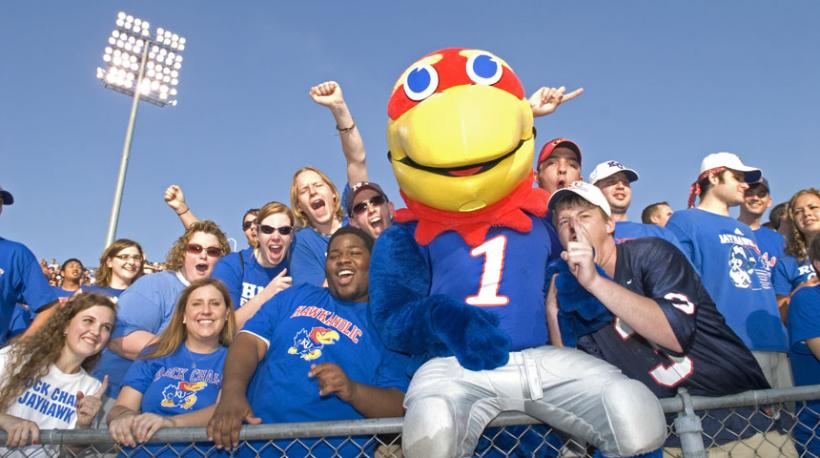 Students celebrate with Jayhawk Mascot, number 1.